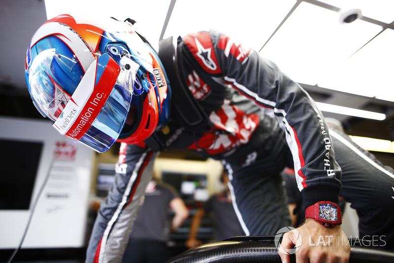 Romain Grosjean, Haas F1 Team, enters his cockpit.