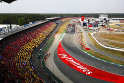 A scenic view of the grid at Hockenheim as fans wear the German national colours