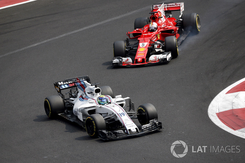 Felipe Massa, Williams FW40 y Sebastian Vettel, Ferrari SF70H battle