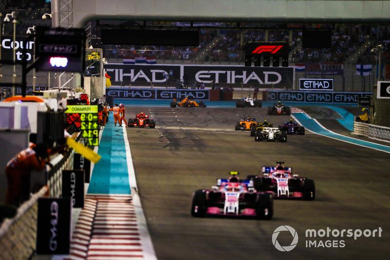 Esteban Ocon, Racing Point Force India VJM11, leads Sergio Perez, Racing Point Force India VJM11, and Marcus Ericsson, Sauber C37