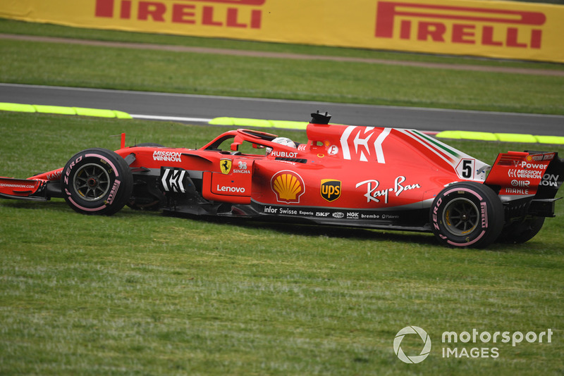 Sebastian Vettel, Ferrari SF71H runs wide across the grass