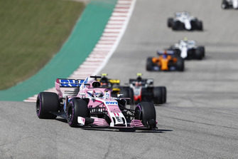 Sergio Perez, Racing Point Force India VJM11, leads Carlos Sainz Jr., Renault Sport F1 Team R.S. 18, Kevin Magnussen, Haas F1 Team VF-18, and the remainder of the field on the formation lap