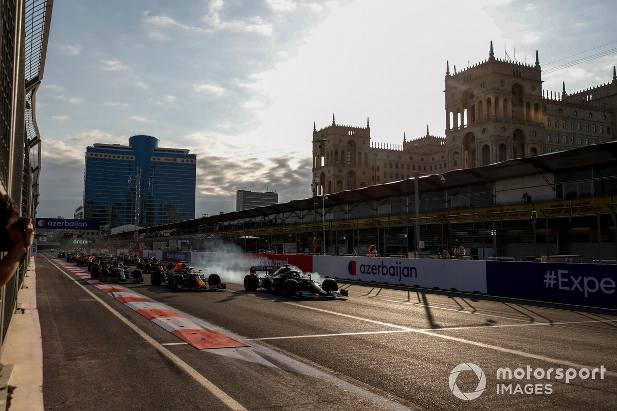 Lewis Hamilton, Mercedes W12 runs wide from Sergio Perez, Red Bull Racing RB16B at the restart of the race