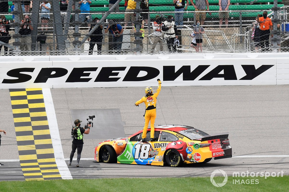 Kyle Busch, Joe Gibbs Racing, Toyota Camry M&M's Mix, celebrates after winning in Kansas.