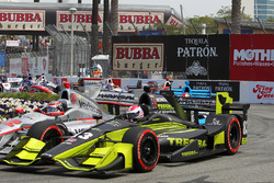 Charlie Kimball, Chip Ganassi Racing Honda side by side with Will Power, Team Penske Chevrolet in turn 3 on first lap