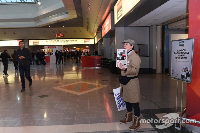A programme seller outside of the Autosport International entrance