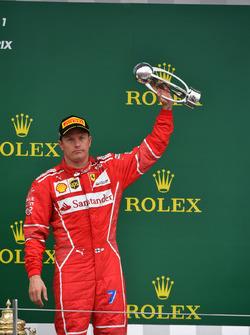 Kimi Raikkonen, Ferrari celebrates on the podium, the trophy