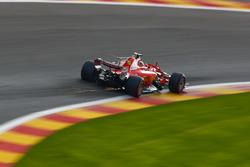 Sparks fly from the car of Sebastian Vettel, Ferrari SF70H