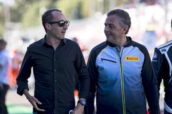 Robert Kubica with Mario Isola, Pirelli on the grid