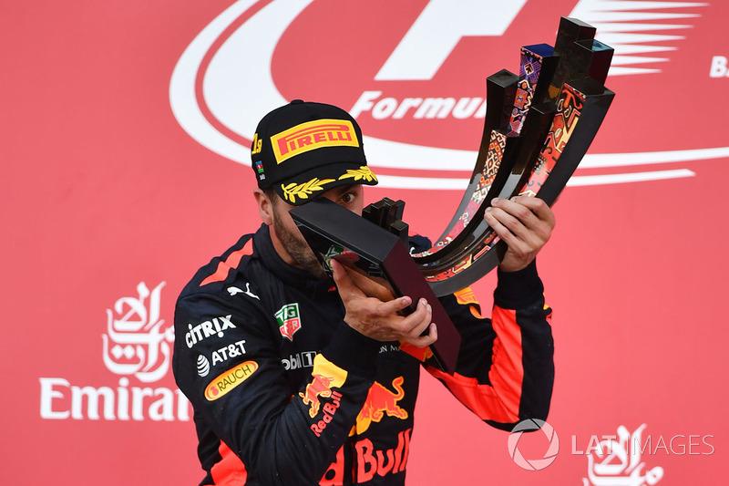 Race winner Daniel Ricciardo, Red Bull Racing celebrates on the podium, the trophy