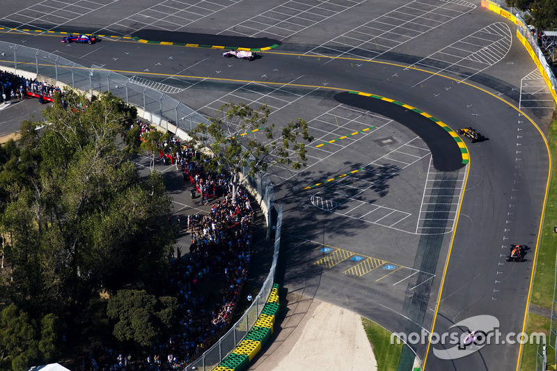 Nico Hulkenberg, Renault Sport F1 Team RS17, leads Fernando Alonso, McLaren MCL32, and Esteban Ocon,