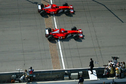 Michael Schumacher and Rubens Barrichello, Ferrari are taken the checkered flag