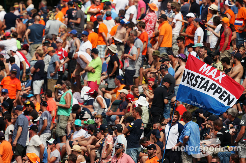 Fans and a flag for Max Verstappen, Red Bull Racing