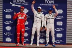 Polesitter Lewis Hamilton, Mercedes AMG F1 celebrates in parc ferme alongside Sebastian Vettel, Ferrari and Valtteri Bottas, Mercedes AMG F1
