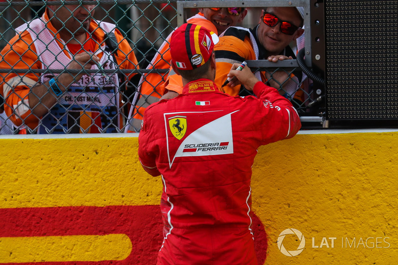 Sebastian Vettel, Ferrari signs autographs in parc ferme