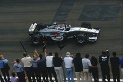 Mika Hakkinen,McLaren MP4/14 Mercedes-Benz, celebrates victory at the finish