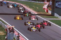 Nigel Mansell, Williams FW11B Honda, lidera a Gerhard Berger, Ferrari F187, Michele Alboreto, Ferrari F187, Nelson Piquet, Williams FW11B Honda, Alain Prost, McLaren MP4/3 TAG Porsche, y Ayrton Senna, Team Lotus Honda 99T