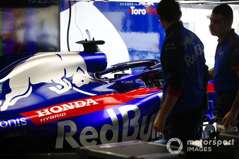 Toro Rosso Honda mechanics work in the garage next to the Brendon Hartley Toro Rosso STR13