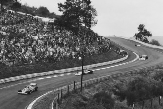 Niki Lauda, Ferrari 312T2, crash, leads Guy Edwards, Hesketh 308D-Ford, 15th position, Brett Lunger, Surtees TS19-Ford, retired and Harald Ertl, Hesketh-Ford 308D, retired onto Adenau Bridge
