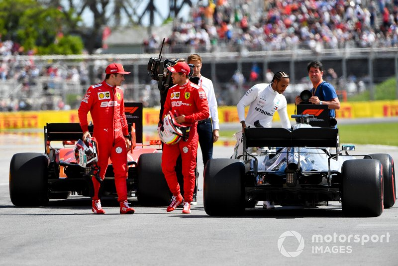 Charles Leclerc, Ferrari, talks with pole man Sebastian Vettel, Ferrari, after Qualifying