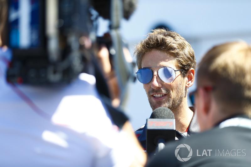 Romain Grosjean, Haas F1 Team, talks to the media in qualifying