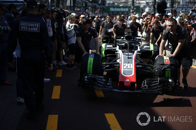Haas F1 Team VF-18 pushed by Haas F1 mechanics