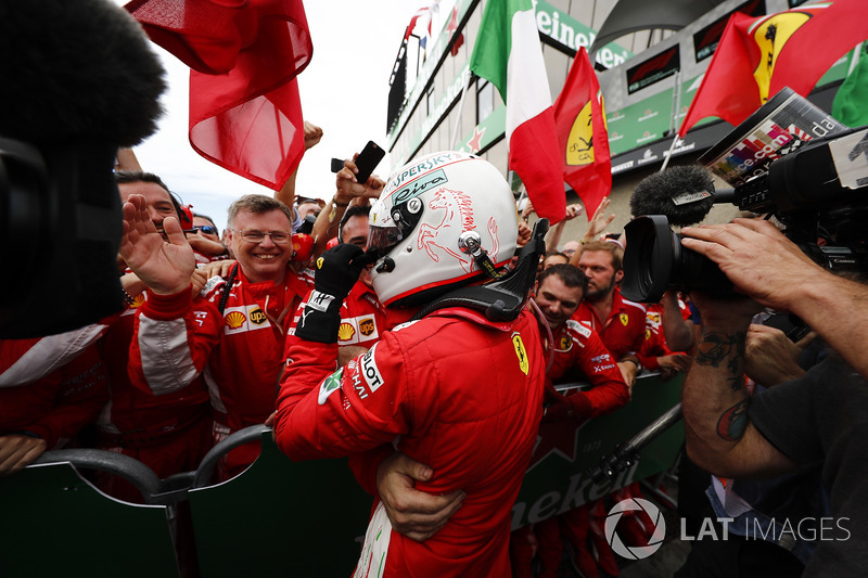 Sebastian Vettel, Ferrari, 1st position, celebrates in Parc Ferme with his team