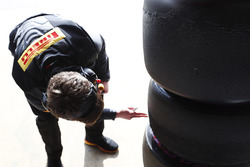A Pirelli tyre technician at work