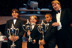 Mika Hakkinen presents to Gary Paffett, Tom Sisley and Lewis Hamilton