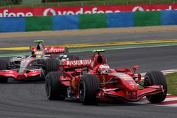 Kimi Raikkonen, Ferrari F2007 leads Lewis Hamilton, McLaren MP4/22