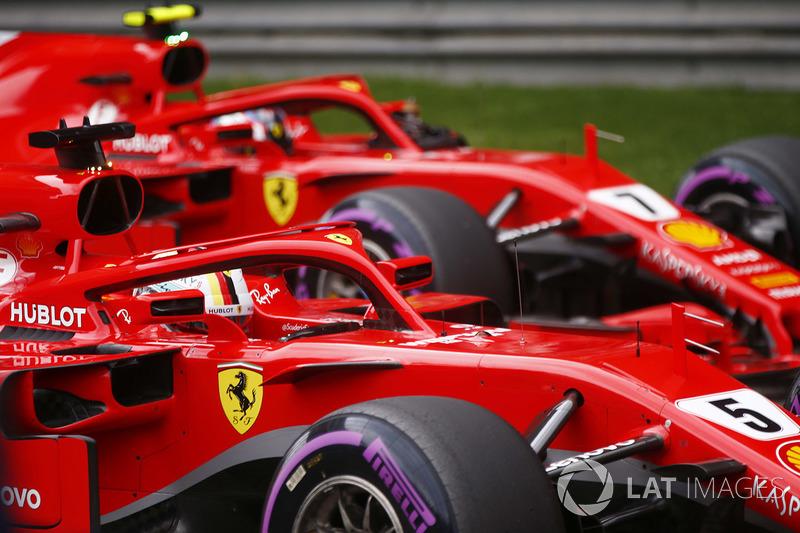 Peraih pole Sebastian Vettel, Ferrari, posisi kedua Kimi Raikkonen, Ferrari