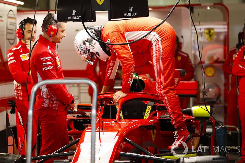 Kimi Raikkonen, Ferrari, climbs out of his car