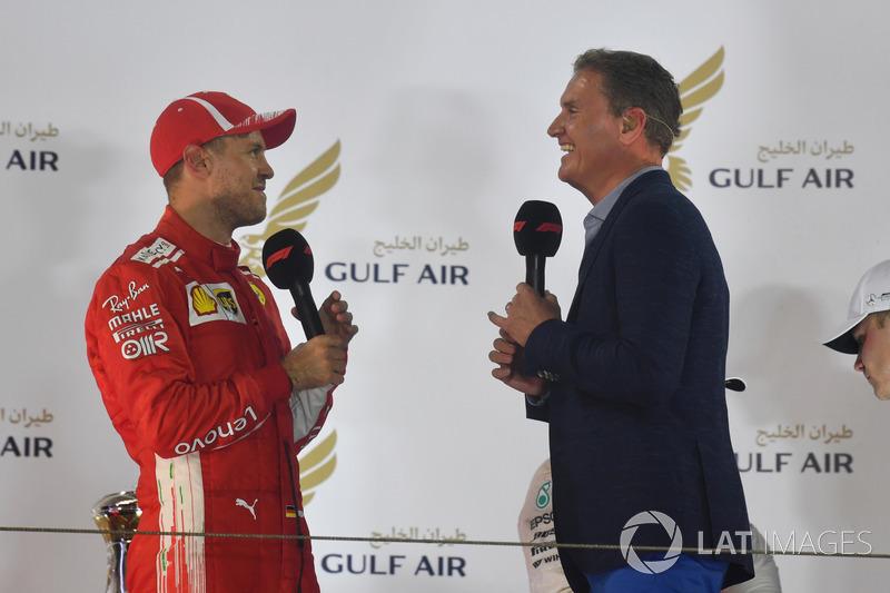 Sebastian Vettel, berbincang dengan David Coulthard