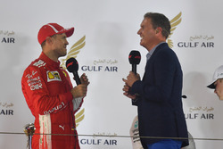 Sebastian Vettel, Ferrari talks with David Coulthard, on the podium