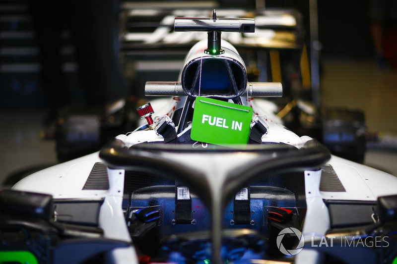 The fuelled up car of Romain Grosjean, Haas F1 Team VF-18, in the garage