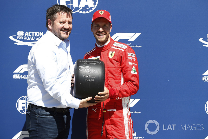 Paul Hembrey, Director, Pirelli Motorsport, presents Sebastian Vettel, Ferrari, with the Pirelli Pol