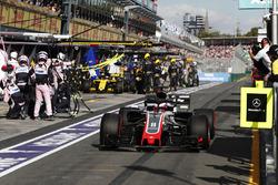 Romain Grosjean, Haas F1 Team VF-18 Ferrari, Nico Hulkenberg, Renault Sport F1 Team R.S. 18, in the pit lane