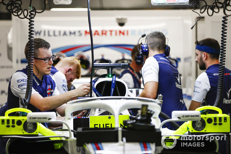 Engineers work on the car of Lance Stroll, Williams FW41