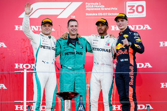 Second place Valtteri Bottas, Mercedes AMG F1, the Mercedes Constructors trophy delegate, Race winner Lewis Hamilton, Mercedes AMG F1, and third place Max Verstappen, Red Bull Racing, on the podium