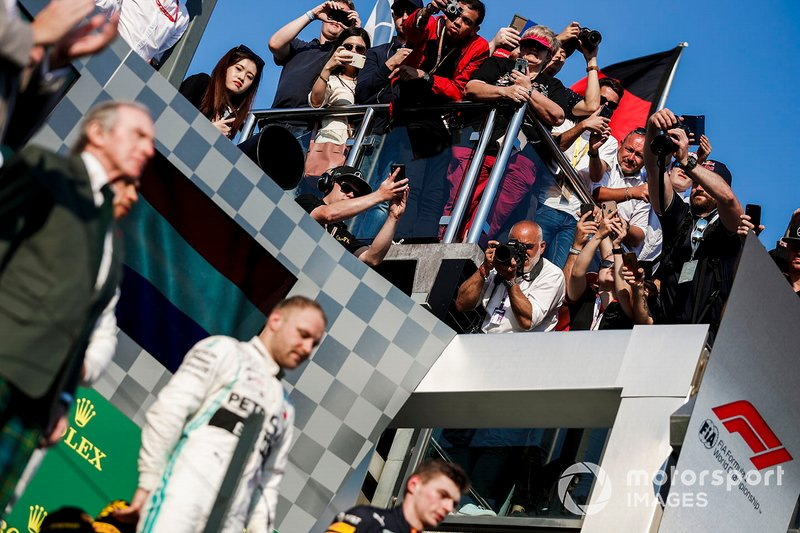 Valtteri Bottas, Mercedes AMG F1, 1st position, and Max Verstappen, Red Bull Racing, 3rd position, on the podium