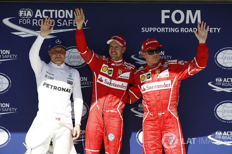 Ganador de la pole  Sebastian Vettel, Ferrari, segundo lugar Kimi Raikkonen, Ferrari, tercer lugar Valtteri Bottas, Mercedes-Benz F1