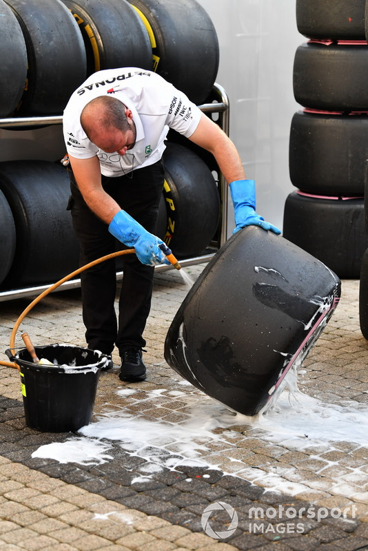 Mercedes AMG F1 mechanic washes Pirelli tyres