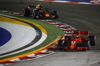 Sebastian Vettel, Ferrari SF71H and Max Verstappen, Red Bull Racing RB14
