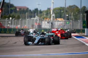 Valtteri Bottas, Mercedes AMG F1 W09, leads Lewis Hamilton, Mercedes AMG F1 W09, and Sebastian Vettel, Ferrari SF71H