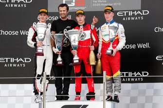 Jake Hughes, ART Grand Prix, Nikita Mazepin, ART Grand Prix, and Simo Laaksonen, Campos Racing, celebrate on the podium