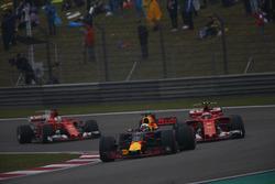 Daniel Ricciardo, Red Bull Racing RB13, leads Kimi Raikkonen, Ferrari SF70H, and Sebastian Vettel, Ferrari SF70H