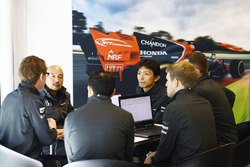 McLaren and Honda team members in discussion