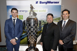 2016 Indy 500 winner Alexander Rossi with the Borg-Warner trophy and team owner Michael Andretti and co-entrant Bryan Herta