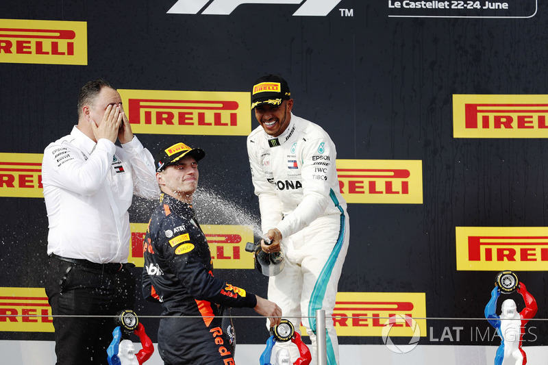 Ron Meadows, Sporting Director, Mercedes AMG, Max Verstappen, Red Bull Racing, and Lewis Hamilton, Mercedes AMG F1, spray the champagne on the podium