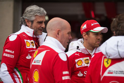 (L to R): Maurizio Arrivabene, Ferrari Team Principal with Jock Clear, Ferrari Engineering Director and Sebastian Vettel, Ferrari